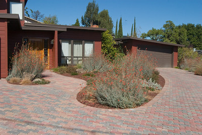 The attractive pattern in the walks and driveway is a complement to the house colors.