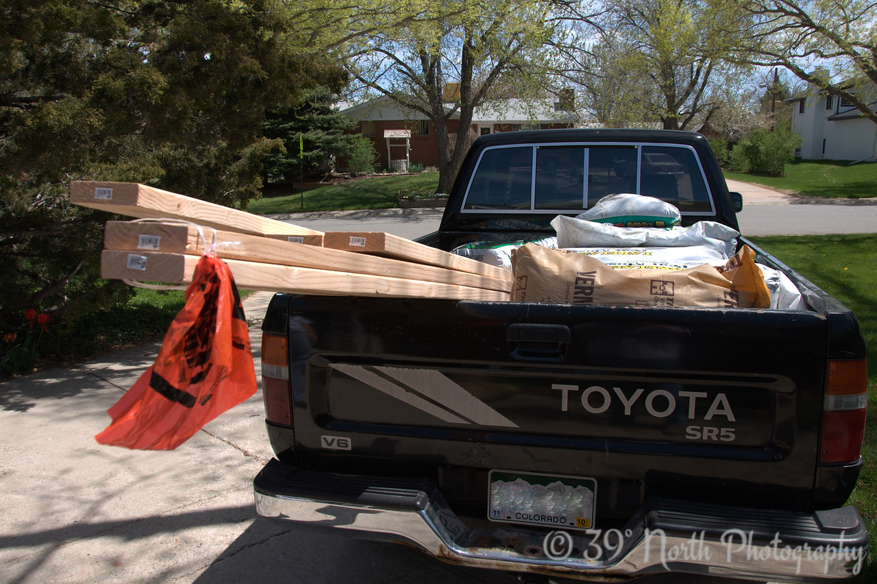 "First step: Plan the layout of the boxes. Second step: Buy materials from Home Depot. You know how Home Depot's slogan is ""You can do it, we can help""? They lied. I tried to get the guy from the garden department to come home with us to help unload the truck (peat moss is HEAVY!) and he wouldn't. So much for ""we can help!"""