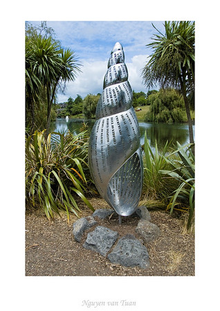 Pupu Harakeke - Flax Snail Virginia King Marine grade 316 stainless steel Stoneleigh sculpture in the gardens Auckland Botanic Gardens New Zealand - Jan 2008