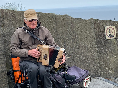 Busker at the Cliffs of Moher