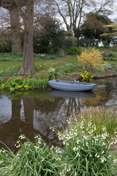 The Beth Chatto Garden with lake and boat