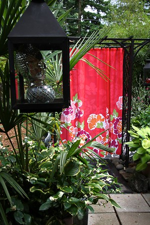 Sitting area remodel 2013 I brought in 2 weather proof fabric shower curtains suspended in my arbors to help divide the space from the rest of the yard