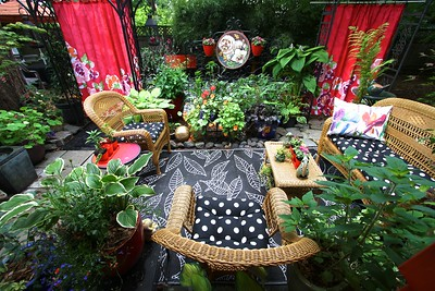 """The view of the sitting area from my front step. There are more details to be added but this is my dream """"secret garden"""" come to life!"""