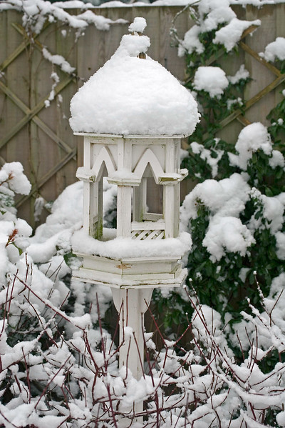 SNOW COVERED GOTHIC BIRD FEEDING STATION