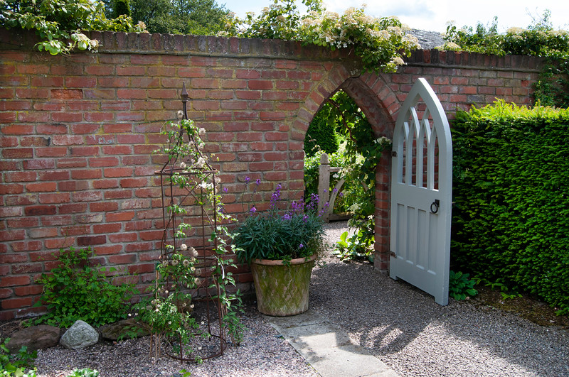 secret door leading from the courtyard garden at Wollerton Old Hall Garden, Shropshire, June,