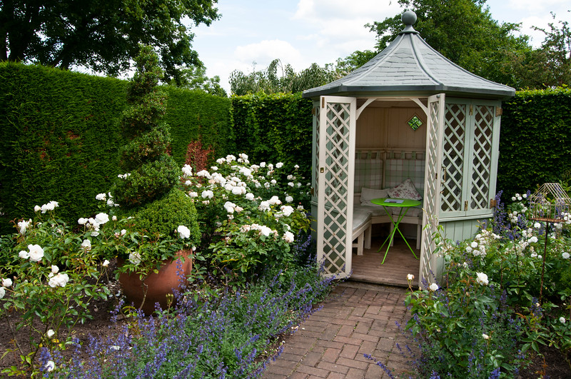summerhouse at the end of the rose garden at Wollerton Old Hall Garden, Shropshire, June,