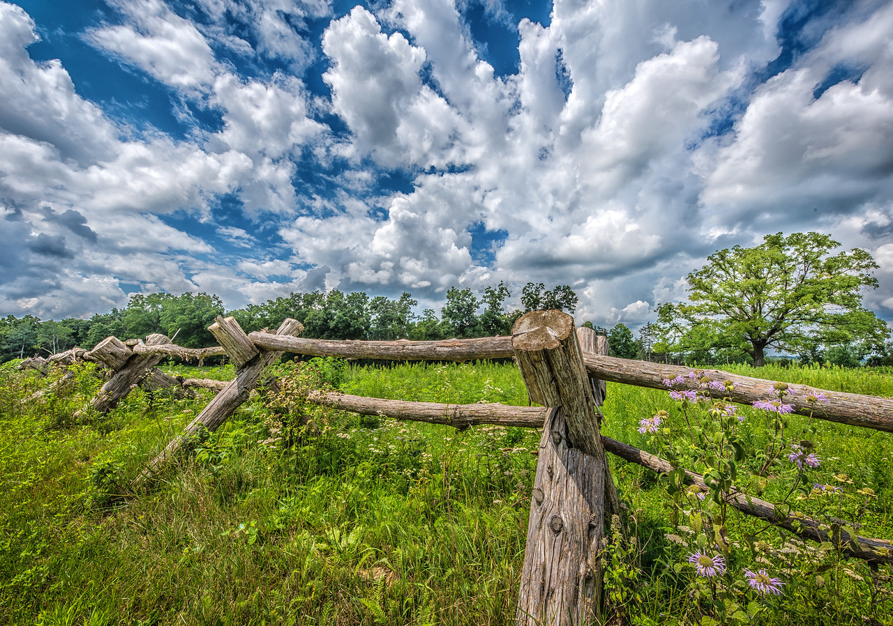 Rail fence and clouds. Bluff country near Rushford, MN.