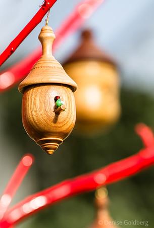 a birdhouse, a tiny glass bird