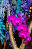 orchids in bright pink against intricate paper leaves