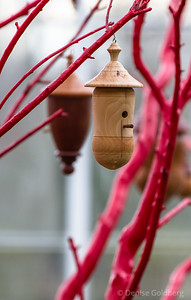 a beautifully carved birdhouse