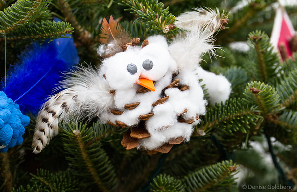 pine cone, feathers, and cotton balls create an owl