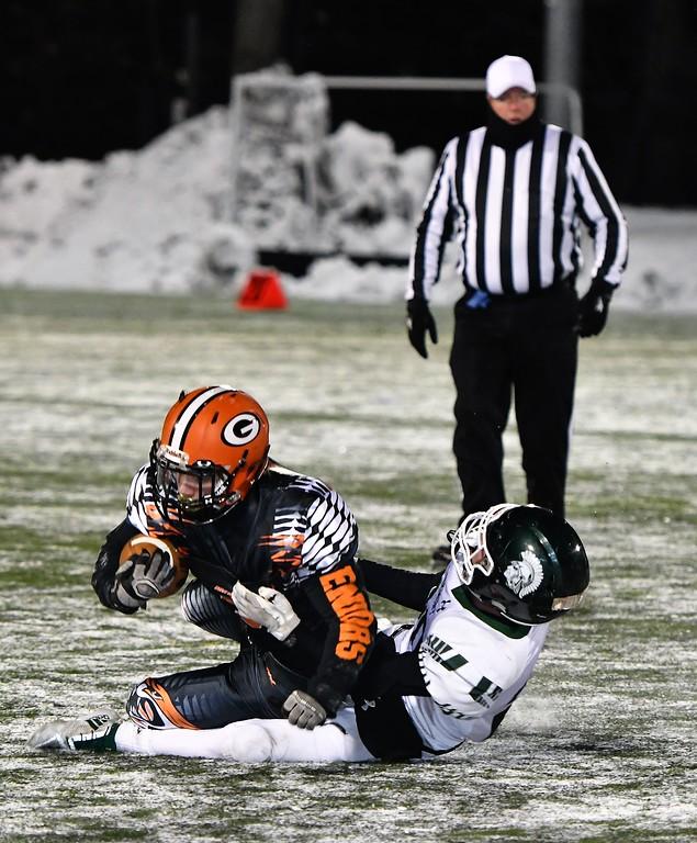 . Gardner\'s Zach Wiseman gets tackled by Mitchell Thomann. Sentinel & Enterprise / Jim Fay