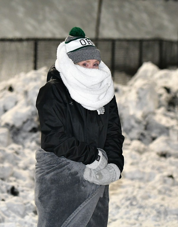 . Layers were the key to keeping warm at the Gardner - Oakmont Football Game on Wednseday night. Sentinel & Enterprise / Jim Fay