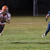 Gardner's Evan Schoonover runs upfield with Quabbin's Joseph Leazott in pursuit. SENTINEL&ENTERPRISE/ Jim Marabello