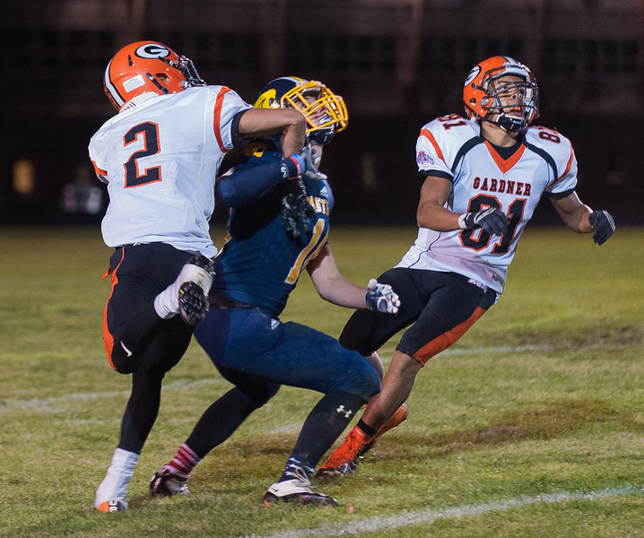 Gardner defenders Josh Correa and Averill Kennedy wait for an incomig pass intended for Quabbin's Travis Lanpher that resulted in an interception. SENTINEL&ENTERPRISE/ Jim Marabello