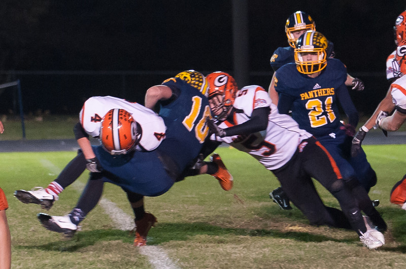 Gardner's Zach Valliere and Marcus Campbell put a hard hit on Quabbins Travis Lanpher late in the game. SENTINEL&ENTERPRISE/ Jim Marabello