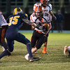 Gardner's Evan Schoonover runs upfield against Travis Mortell. SENTINEL&ENTERPRISE/ Jim Marabello