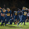 Quabbin's Collin Sweeney leads the charge off the field after intercepting a pass at the 2 yard line in double OT to preserve a 54-48 win against Gardner. SENTINEL&ENTERPRISE/ Jim Marabello