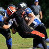 Gardner High School football played Murdock High School on Saturday, September 29, 2018. GHS's Anthony Richard gets tackled by some MHS as he tries to hold onto the ball. SENTINEL & ENTERPRISE/JOHN LOVE