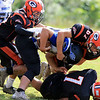 Gardner High School football played Murdock High School on Saturday, September 29, 2018. GHS's, l-r, Noah Martins, Jacob Ramey and Javian Colon take down MHS's Joe Marobella. SENTINEL & ENTERPRISE/JOHN LOVE