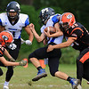 Gardner High School football played Murdock High School on Saturday, September 29, 2018. GHS's Marcus Bruno tackles MHS's Jack Polcari during action in the game. Coming in from the left to help is GHS's Zach Lemoine. SENTINEL & ENTERPRISE/JOHN LOVE