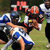 Gardner High School football played Murdock High School on Saturday, September 29, 2018. GHS's Malakide Sieng is taken down by MHS's Cam Monette as he goes over Matt Marabella. SENTINEL & ENTERPRISE/JOHN LOVE