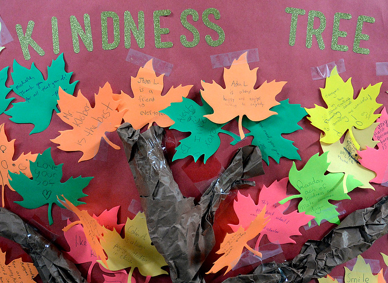 Compliments and kind words written on paper leaves decorate the Kindness Tree at Garfield Elementary School Tuesday, Jan. 24, 2017. Students at the school are participating in the Great Kindness Challenge, where they are promoting acts of kindness among their students. (Photo by Jenny Sparks/Loveland Reporter-Herald)