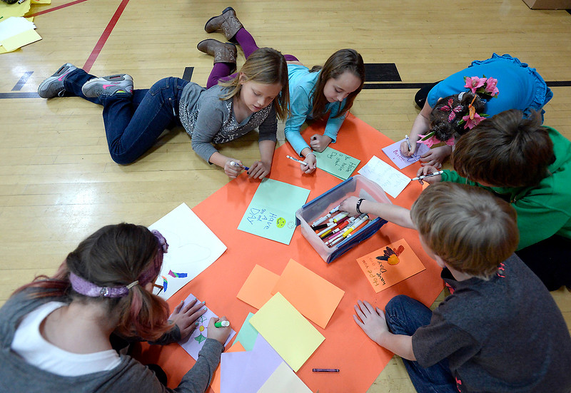 Garfield Elementary School students create hand-made cards for Meals on Wheels clients Tuesday, Jan. 24, 2017, in the gym at their school. Clockwise from left are Bella Cooper, 9, Alexandria Abear, 9, Koral Keating, 10, Scarlette Muirbrook, 9, Gabe Hamilton, 10, and Zandyr Burroughs, 10. Students at the school are participating in the Great Kindness Challenge, where they are promoting acts of kindness among their students. (Photo by Jenny Sparks/Loveland Reporter-Herald)