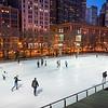 McCormick Tribune ice rink ice skating ice skaters at dusk winter Millennium Park