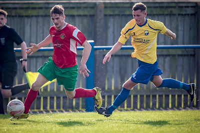 Ryan Sharrocks runs down Railway's right wing and crosses the ball for Paul Beesley to shoot.