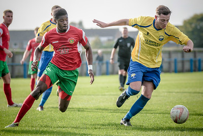 Brandon Deane chases down the Garforth Defender as he attempts to run the ball out of the penalty box.