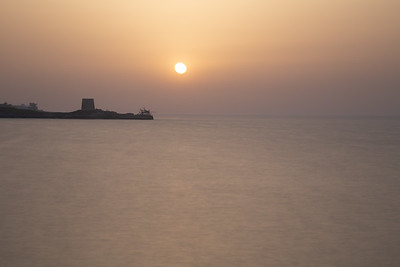 Sunset over the sea in summer haze