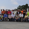Fort Benning Area Engineer George Condoyiannis and project engineers with the Savannah District, US Army Corps of Engineers, assemble with representatives from prime contractors (Caddell, Walton and Cheoah construction companies) for a group photo at the intersection of Lorraine and Buena Vista roads to celebrate the functional completion of Training Road and Tank Trail projects north of Harmony Church Sept. 15, 2011. Photos by Cindy Andruss.