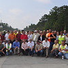 George Condoyiannis, P.E., Area Engineer, US Army Corps of Engineers, (1st row, 9th from left), USACE engineers and contractors (Caddell, Walton, and Cheoah) gather at the intersection of Lorraine and Buena Vista roads to celebrate the functional completion of Training Road and Tank Trail projects north of Harmony Church Sept. 15, 2011. Photos by Cindy Andruss.
