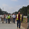 Engineers with the US Army Corps of Engineers and prime contractors (Caddell, Walton, and Cheoah) walk past the intersection of Lorraine and Buena Vista roads to celebrate the functional completion of Training Road and Tank Trail projects north of Harmony Church Sept. 15, 2011. Photos by Cindy Andruss.