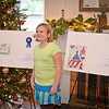 05 DEC 2011 (Fort Benning, GA) - Elementary students who won first, second and third place in the Holiday Card contest gathered at Riverside to receive their rewards from commanding general MG Robert Brown. Morgan Boal stands next to her winning Holliday card. Photo by Kristian Ogden
