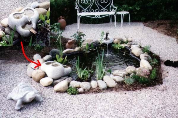 Teichanlage mit Quellstein