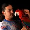 Rigdzin Zeoli with Hakan - green-wing macaw<br /> photo by Bonnie Jay