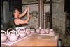 Gary pulling handles for teapots.