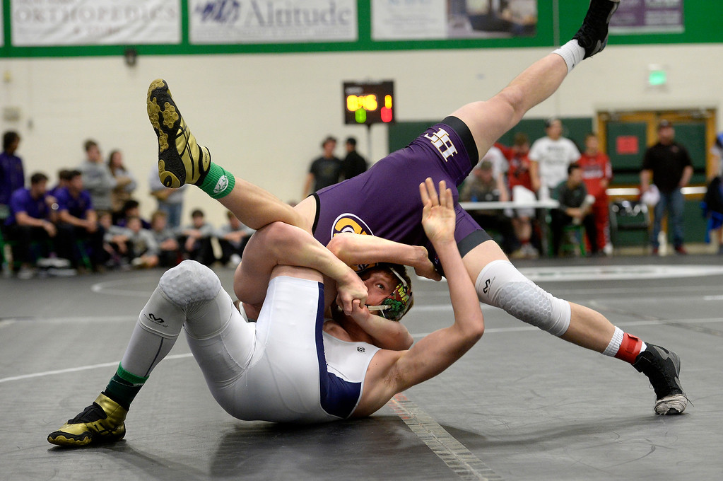 . NIWOT, CO: January 5, 2019:   Holy Family�s Hunter Branson pins Platte Valley�s Ethan Malovich in the title match at 170-pounds.  For more photos, go to bocopreps.com. (Photo by Cliff Grassmick/Staff Photographer)