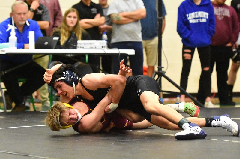 Longmont's Gio Wilson, top, wrestled Rocky Mountain's Spencer Bowman in the 126-pound championship match at the Gary Daum Classic.<br /> Brad Cochi Photo