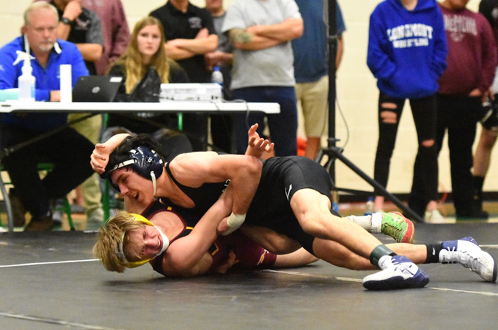 . Longmont�s Gio Wilson, top, wrestled Rocky Mountain�s Spencer Bowman in the 126-pound championship match at the Gary Daum Classic. Brad Cochi Photo