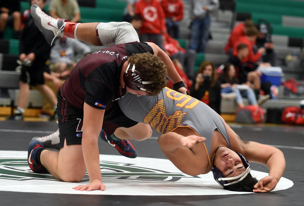. James Hochanedel, of Ft. Morgan, beats Alex Ortiz, of Skyline, at the Gary Daum Invitational Wrestling Tournament on Saturday at Niwot High School. Cliff Grassmick  Photographer January 6, 2018