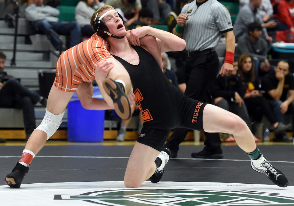 . Cole Stephenson, of Lewis-Palmer, beats Zach Roach, of Erie, at the Gary Daum Invitational Wrestling Tournament on Saturday at Niwot High School. Cliff Grassmick  Photographer January 6, 2018