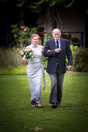 Kirsty with Dad walking to the 'altar'