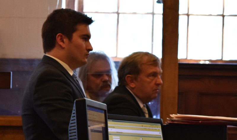Assistant District Attorney Gregory Galizio, at left, defendant Gary Record, center, and attorney Robert Normandin, right, look toward a judge as Record is arraigned in Lowell District Court on Monday. SUN/Robert Mills