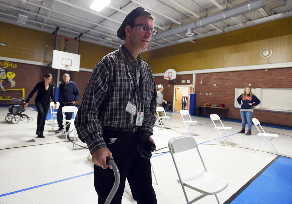 . Michael Hancey walks around chairs during Gary Sobol\'s class at the Rocky Mountain MS Center in Westminster. Gary Sobol  is  founder and CEO of The Parkinson\'s Network, a nonprofit organization that teaches exercise classes specifically for people with Parkinson\'s, MS, or other neurological disabilities. Cliff Grassmick  Photographer January 24, 2018