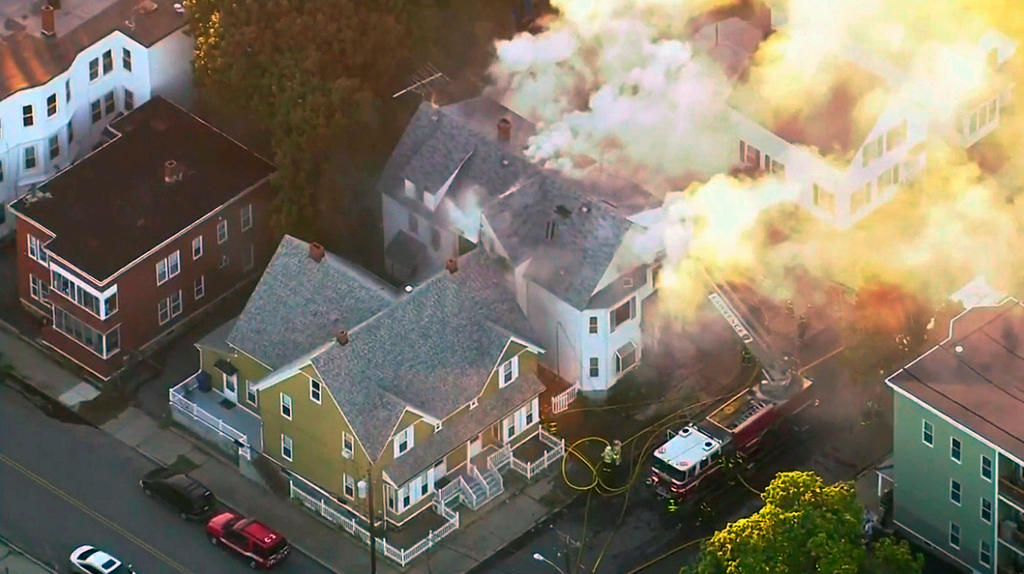 . In this image take from video provided by WCVB in Boston, firefighters battle a large structure fire in Lawrence, Mass, a suburb of Boston, Thursday, Sept. 13, 2018. Emergency crews are responding to what they believe is a series of gas explosions that have damaged homes across three communities north of Boston. (WCVB via AP)