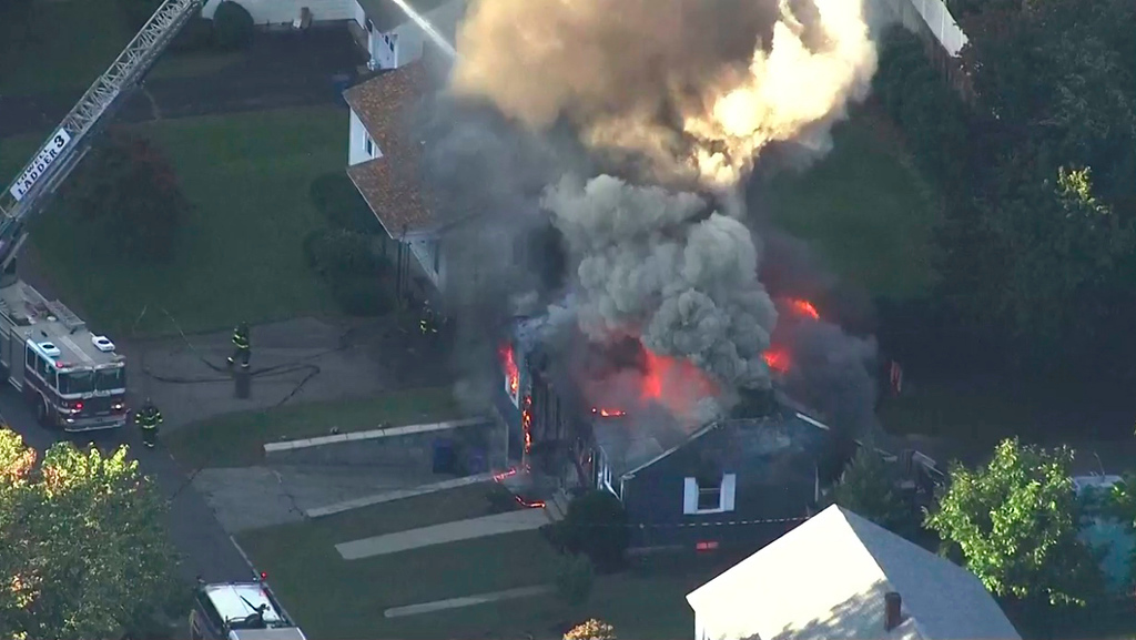 . In this image take from video provided by WCVB in Boston, firefighters battle a raging house fire in Lawrence, Mass, a suburb of Boston, Thursday, Sept. 13, 2018. Emergency crews are responding to what they believe is a series of gas explosions that have damaged homes across three communities north of Boston. (WCVB via AP)
