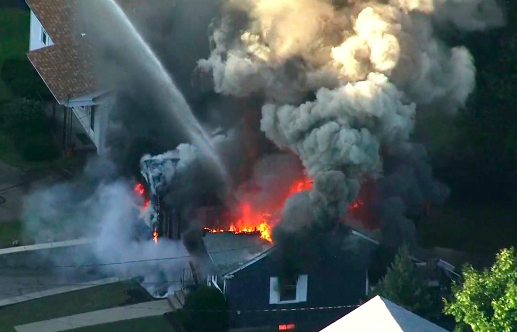 . In this image take from video provided by WCVB in Boston, flames consume the roof of a home in Lawrence, Mass, a suburb of Boston, Thursday, Sept. 13, 2018. A series of gas explosions killed a teenager, injured at least 10 other people and ignited fires in at least 39 homes in three communities north of Boston, forcing entire neighborhoods to evacuate as crews scrambled to fight the flames and shut off the gas. (WCVB via AP)
